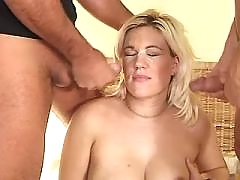 Pregnant blonde gets facial in orgy